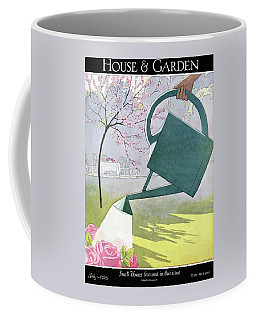 A Watering Can Above Pink Roses Coffee Mug