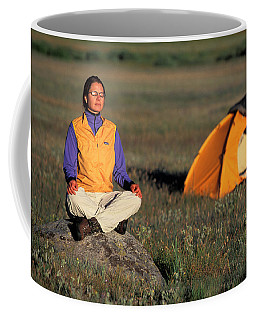 A Woman Meditating In A Meadow Coffee Mug