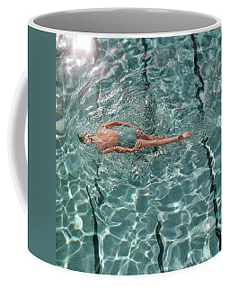 A Woman Swimming In A Pool Coffee Mug