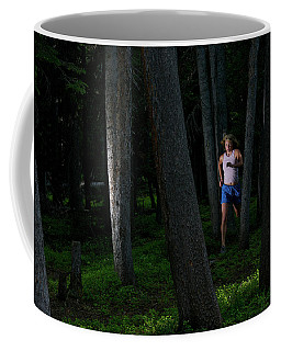 A Woman Trail Running In The Forests Coffee Mug