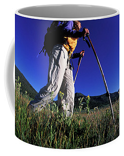 A Woman Trekking Through An Alpine Coffee Mug