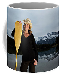A Women Prepares For The Paddle Ahead Coffee Mug