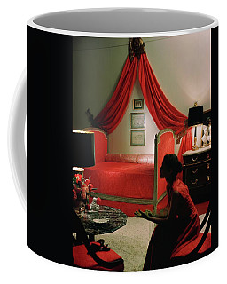A Young Woman Sitting In A Red Bedroom Coffee Mug