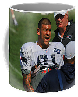 Coffee Mug featuring the photograph Aaron Hernandez With Patriots Coaches by Mike Martin