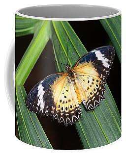 Butterfly On Leaves Coffee Mug by Tamara Becker