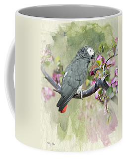 African Gray Among The Blossoms Coffee Mug by Betty LaRue