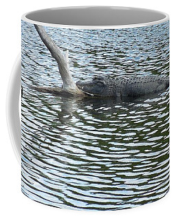 Coffee Mug featuring the photograph Alligator Resting On A Log by Ron Davidson