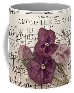 Coffee Mug featuring the photograph Among The Pansies  by Sandra Foster