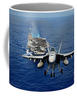 Coffee Mug featuring the photograph An Fa-18 Hornet Demonstrates Air Power. by Paul Fearn
