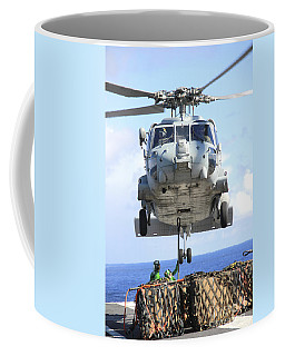 An Hh-60h Sea Hawk Helicopter Picks Coffee Mug
