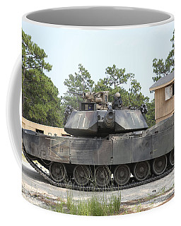 An M1a1 Abrams Tank Takes A Defensive Coffee Mug