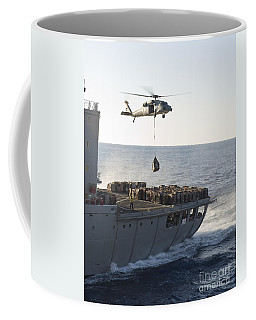 An Mh-60s Sea Hawk Helicopter Carries Coffee Mug