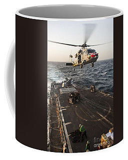 An Mh-60s Sea Hawk Helicopter Delivers Coffee Mug