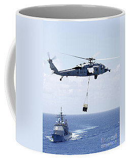 An Mh-60s Sea Hawk Helicopter Flying Coffee Mug