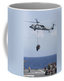 An Mh-60s Sea Hawk Picks Up Cargo Coffee Mug
