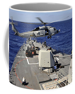 An Sh-60b Sea Hawk Helicopter Picks Coffee Mug