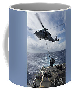 An Sh-60s Sea Hawk Delivers Supplies Coffee Mug