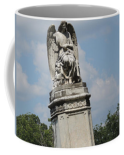 Coffee Mug featuring the photograph Angel Made From Stone by Aaron Martens