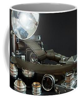Coffee Mug featuring the photograph Antique Cameras by Gunter Nezhoda