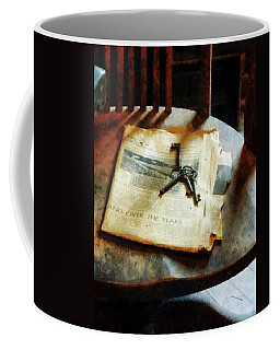 Coffee Mug featuring the photograph Antique Keys On Newspaper by Susan Savad