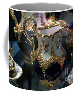 Coffee Mug featuring the photograph Antique Porcelain Coffee Set In Show Case by Gunter Nezhoda