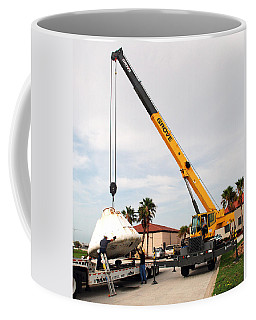 Coffee Mug featuring the photograph Apollo Capsule Going In For Repairs by Science Source