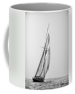 A Tall Ship In Mediterranean Water Approaching To Lighthouse Of Isla Del Aire - Menorca Coffee Mug