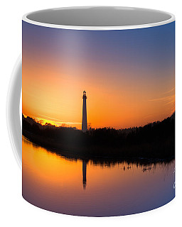 As The Sun Sets And The Water Reflects Coffee Mug by Michael Ver Sprill