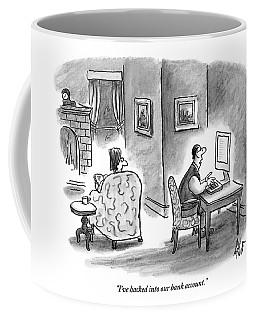 At Home, A Husband At His Computer Talks Coffee Mug