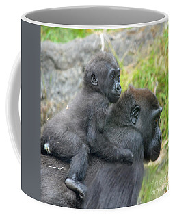 Coffee Mug featuring the photograph Baby Gorilla Going For A Ride  On Mommys Back by Jim Fitzpatrick