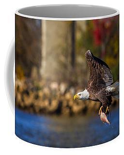 Bald Eagle In Flight Over Water Carrying A Fish Coffee Mug