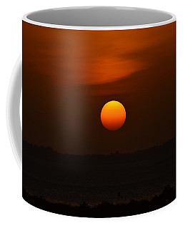 Coffee Mug featuring the photograph Ball Of Fire by Debra Martz