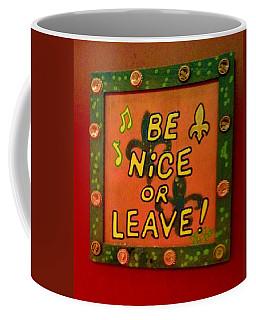 Be Nice Or Leave Coffee Mug by Deborah Lacoste