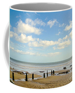 Coffee Mug featuring the photograph Beach Skies by Suzanne Oesterling