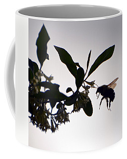 Coffee Mug featuring the photograph Bee In Flight  by Kerri Farley