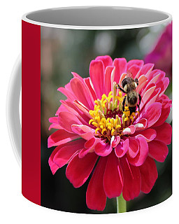 Coffee Mug featuring the photograph Bee On Pink Flower by Cynthia Guinn