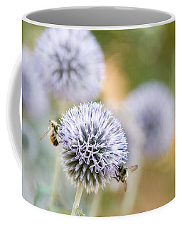 Coffee Mug featuring the photograph Bees In The Garden by Peggy Collins