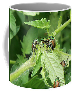 Coffee Mug featuring the photograph Beetle Posse by Thomas Woolworth