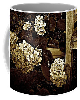 Coffee Mug featuring the photograph Bench With Hydrangeas by Patricia Strand