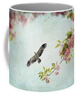 Bird And Pink And Green Flowering Branch On Blue Coffee Mug by Brooke T Ryan