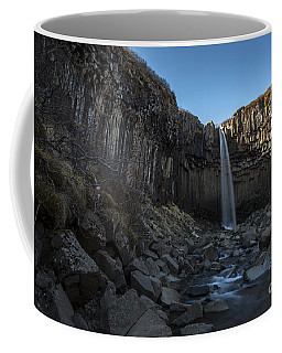 Coffee Mug featuring the photograph Black Waterfall by Gunnar Orn Arnason