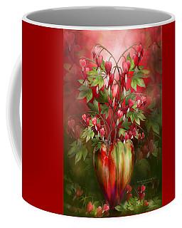Coffee Mug featuring the mixed media Bleeding Hearts In Heart Vase by Carol Cavalaris