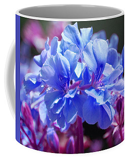 Coffee Mug featuring the photograph Blue And Purple Flowers by Matt Harang