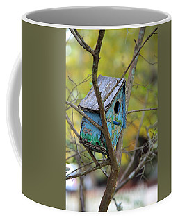 Coffee Mug featuring the photograph Blue Birdhouse by Gordon Elwell