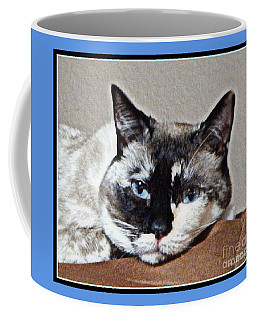 Coffee Mug featuring the photograph Blue Eyes by Bobbee Rickard
