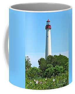 Blue Skies Over Cape May Light  Coffee Mug by Nancy Patterson