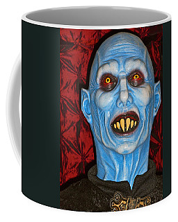 Coffee Mug featuring the photograph Blue Vampire by Joan Reese