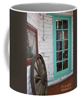 Coffee Mug featuring the photograph Blue Window And Wagon Wheel by Dora Sofia Caputo Photographic Art and Design