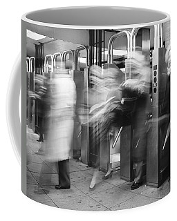 Coffee Mug featuring the photograph Blurred In Turnstile by Dave Beckerman