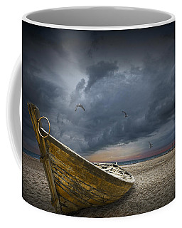Boat With Gulls On The Beach With Oncoming Storm Coffee Mug